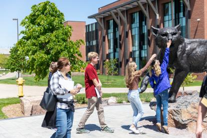 "Students ""booping"" the snout of the Wildcat statue"