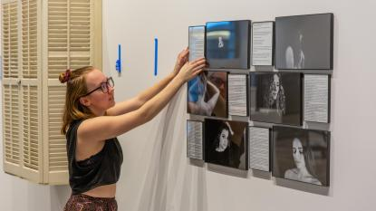 Art student setting up senior exhibit
