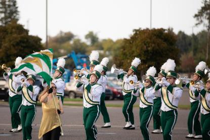 Marching band in NMU's homecoming parade