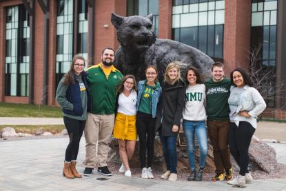 Students with the Wildcat statue