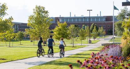 students biking in academic mall