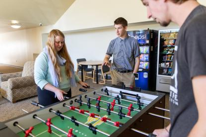Students playing foosball