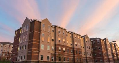 The Woods residence hall complex at sunset