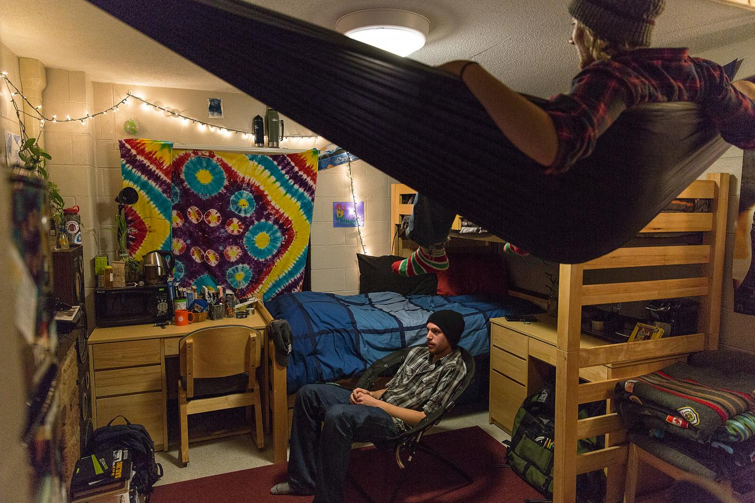 Two male students in a residence hall room