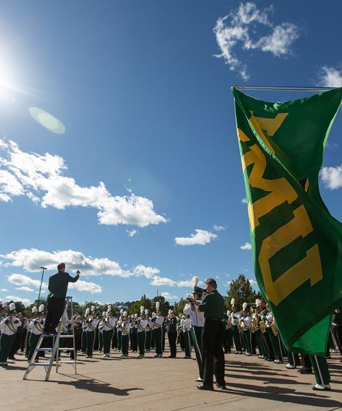 Marching Band with NMU flag