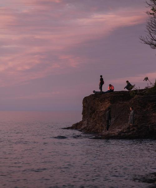 Students enjoying a sunset on Presque Isle