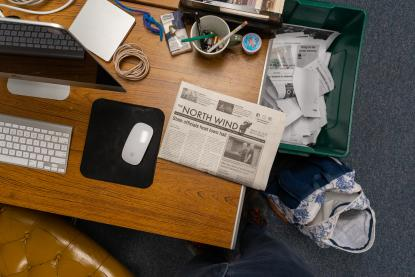 Aerial view of a student writer's desk at the North Wind office