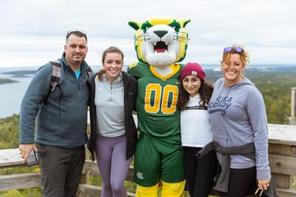 Family with Wildcat Willy on top of Sugarloaf Mountain