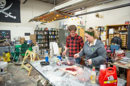 Two students working in the scene shop