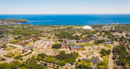 Aerial photo of NMU's campus and Marquette, MI